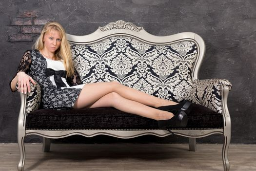 The photo shows a girl on the couch.