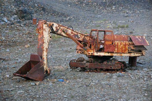 Old broken abandoned rusty excavator at mine