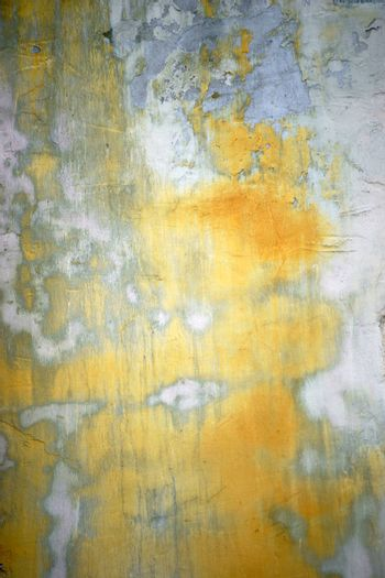 A bright wall with traces of water and sanded lichens.