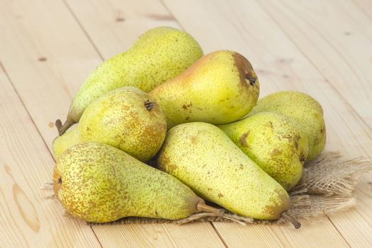Juicy fresh pears on wooden background