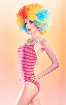 Fashion beauty woman in swimsuit, vivid afro model