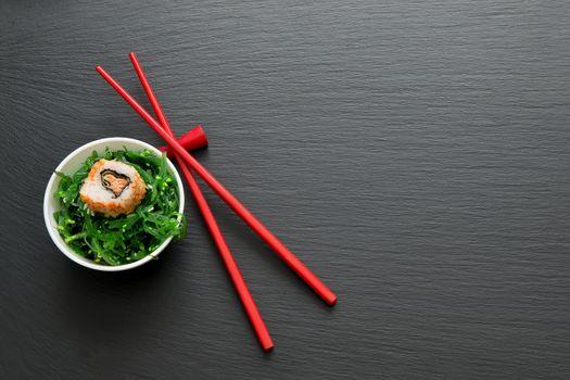 Sushi roll on salad