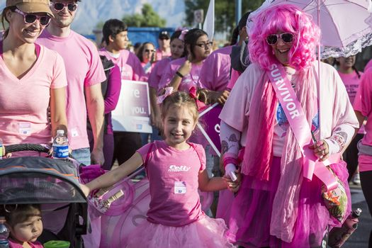 Breast Cancer Survivor and Other Walkers at Awareness Event