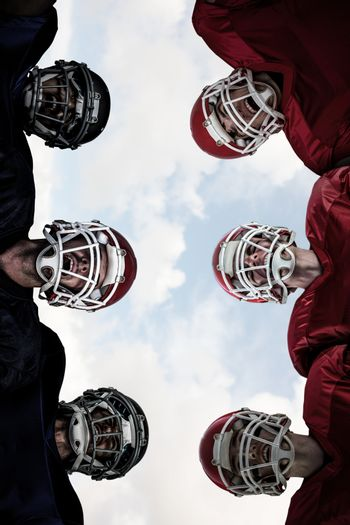 Composite image of american football huddle