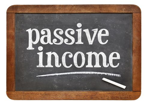 passive income sign - white chalk text on a vintage slate blackboard