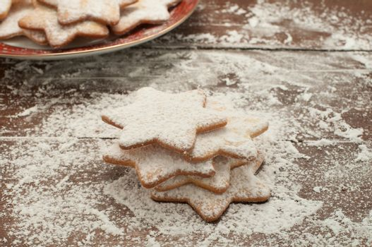 Christmas cookies in the shape of star with flour and butter