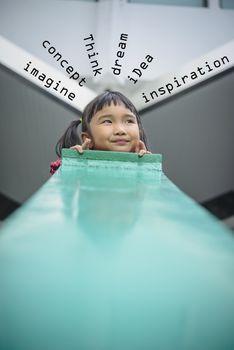 Asian kid with imagine mood