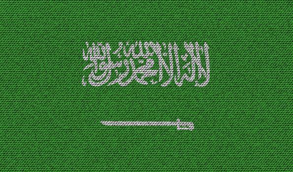 Flags Saudi Arabia on denim texture. Vector
