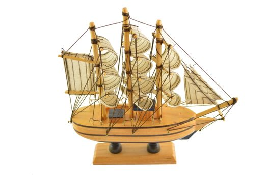 Closeup of a model ship isolated on white background