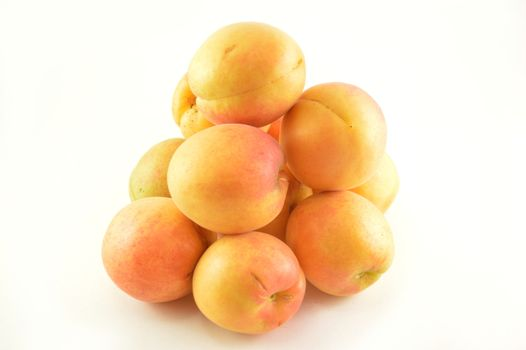 Group of apricots on white background