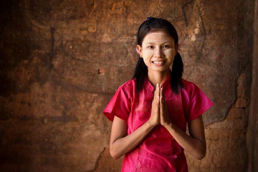 Young Myanmar girl praying