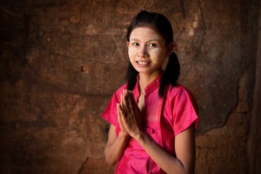 Young Myanmar girl blessing