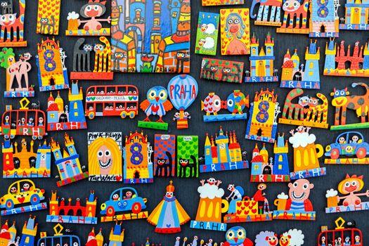 PRAGUE, CZECH REPUBLIC - DECEMBER 29, 2015:Traditional wooden colorful souvenir magnets on display in Prague, Czech Republic