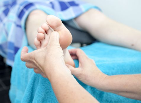 Massage of feet by pedicure