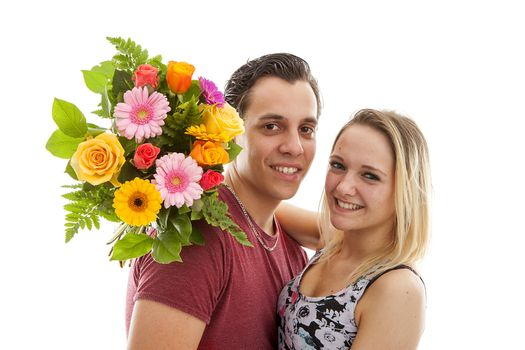 Girl is happy with bouquet of flowers giving by boyfriend over white background