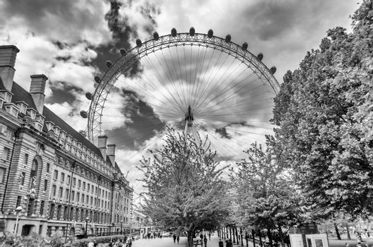LONDON - MAY 28: The Coca-Cola London Eye on May 28, 2015. The ferris wheel is 135 metres (443 ft) tall and the wheel has a diameter of 120 metres (394 ft)