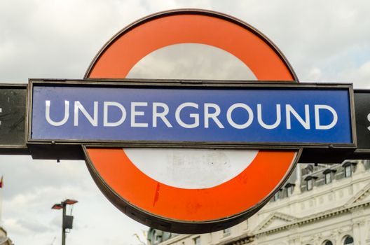 LONDON - MAY 28: Subway sign in London, May 28, 2015. The London Subway system serves 270 stations and has 402 kilometres (250 mi) of track.