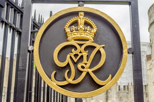 LONDON - MAY 29: Royal Crest on a gate at Tower of London on May 29, 2015. The Tower of London is home of the Crown Jewels of England