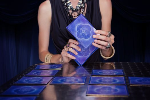 Composite image of fortune teller forecasting the future with ta