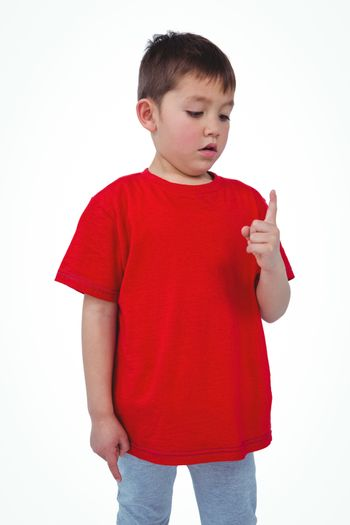 Unsmiling boy looking at his finger
