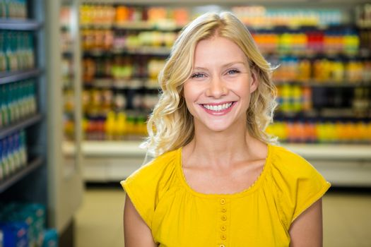 Portrait of smiling woman standing in aisle