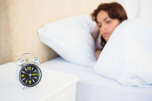 Sleepy woman in her bed