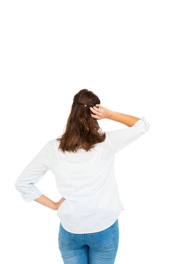 Rear view of woman scratching her head