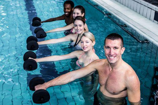 Fitness group doing aqua aerobics