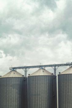 Grain silos on cloudy day