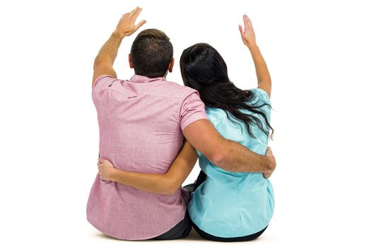 Rear view of couple with arm around