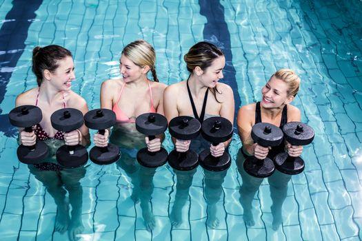 Fit people doing an aqua aerobics class
