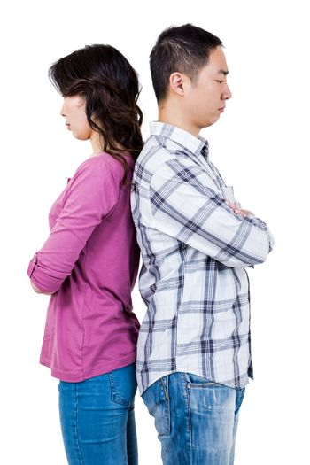Annoyed couple with backs to each other