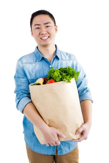 Portrait of man with grocery bag