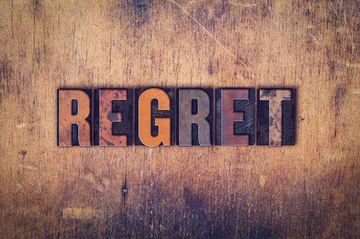 Regret Concept Wooden Letterpress Type