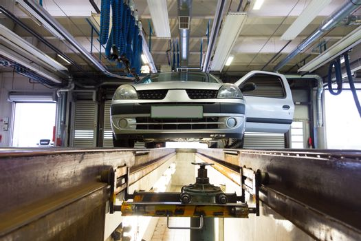 Car on service platform in garage.