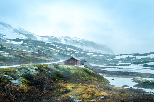 Norway landscape, a small village in inclement weather snowstorm and fog in the mountains. Beautiful Nature Norway.