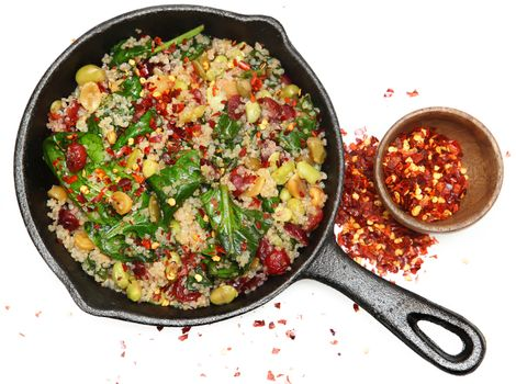 Top View Quinoa Spinach and Cranberry Salad in Cast Iron Skillet