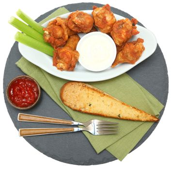 Spicy Chicken Wings with Celery Sticks and Ranch