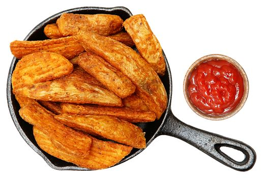 Baked Seasoned Potato Wedges in Cast Iron Skillet With Ketchup
