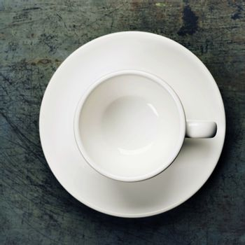 Empty espresso cup on a saucer