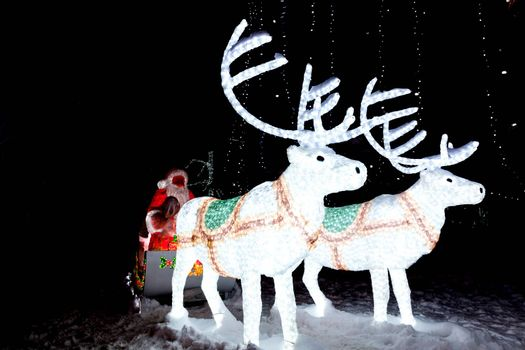 The photograph depicts Santa Claus in a sleigh