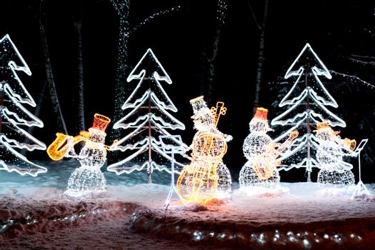 The photo shows Snowmen playing musical instruments
