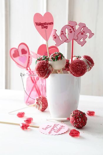 Closeup of cake pops with decorations on kitchen table