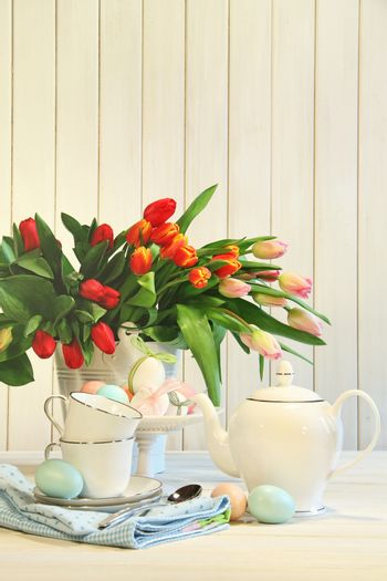 Tulips and colored eggs for Easter