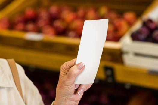 Female consumer holding a receipt