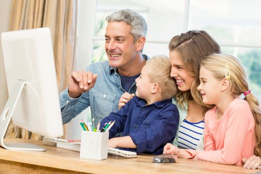 Happy family using the computer at home