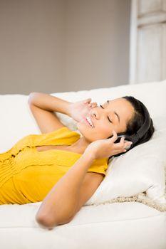 Peaceful brunette with headphones