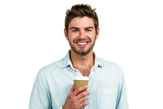 Smiling man with disposable cup