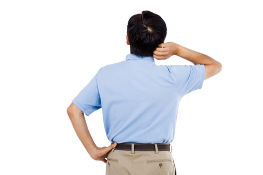 Rear view of man scratching head