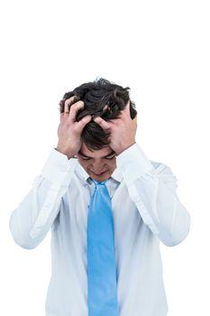 Irritated asian businessman holding his head